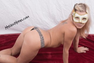 Topless Masquerade Model